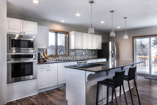 Refinishing your old kitchen cabinets can save you money in Fargo, ND.
